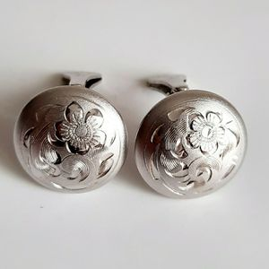 Silver tone clip on floral earrings